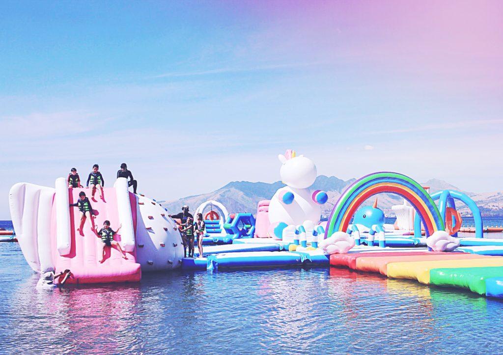 Inflatable slides at Unicorn Island - Unicorns Fairies & Glitter